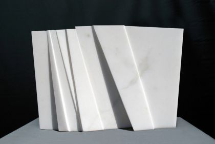 Ancient Silence: Carrara marble,  11 ½ x 18 x 5 in. 29.2 x 45.7 x 12.7 cm., stone base: 1 x 18 5/8 x 10 in. / 2.5 x 47.3 x 25.4 cm